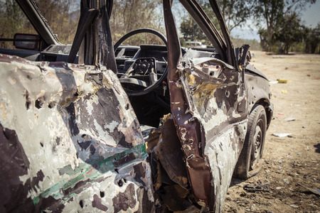 assassinate: simulated wrecked car evidence from explosion in forensic training with cinematic tone