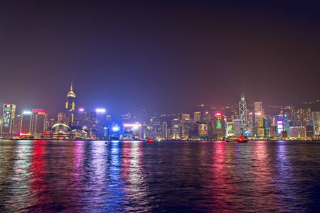 Hong Kong - December 9, 2017. New year and Christmas skyline shines landmark at Victoria harbour night scene with fog in Hong Kong winter festival. Hong Kong  has one of the world's most festive Christmases and New year count down