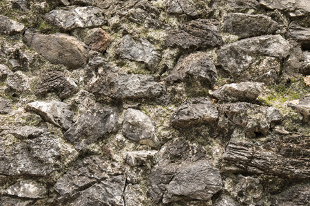 vintage exterior rock wall with moss and lichen textured and background Imagens