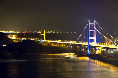 Night scene Tsing Ma double-decked suspension bridge between Ma Wan island and Tsing Yi island in Hong Kong, China