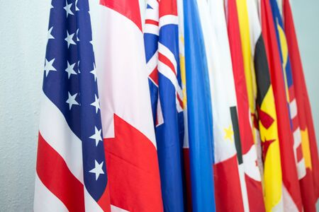 Group of United States and North American Asia Pacific flags in Internationl meeting Imagens