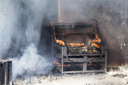 chair and furniture in house after burned by fire with smoke and dust in burn scene of arson investigation course