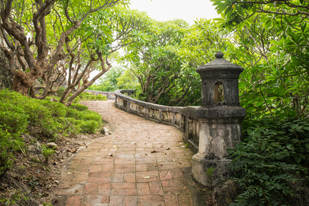 vintage walkway surround with verdant plant of  Phra Nakhon Khiri historical park at Petchaburi, Thailand