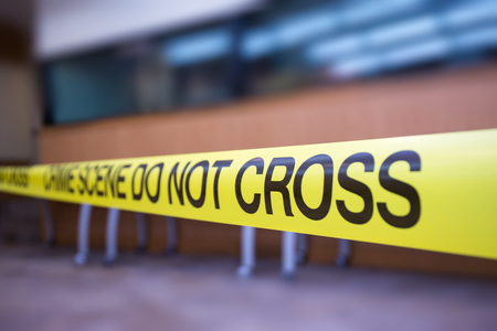 Crime scene tape focus on word cross with copy space