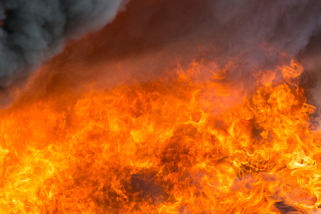 fire and smoke from furniture burning in conflagration for texture and background Imagens