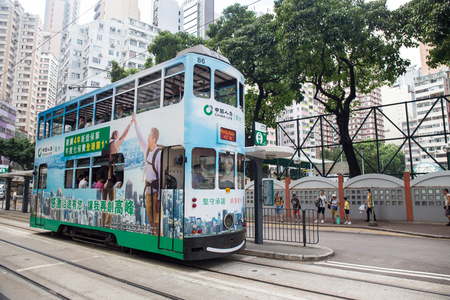 Hong Kong S.A.R. - September 22, 2017: Double decker tram on the street in Wan Chai.Tram or Ding Ding is major tourist attraction and one of the most environmentally friendly ways of travelling in Hong Kong Imagens - 98326808