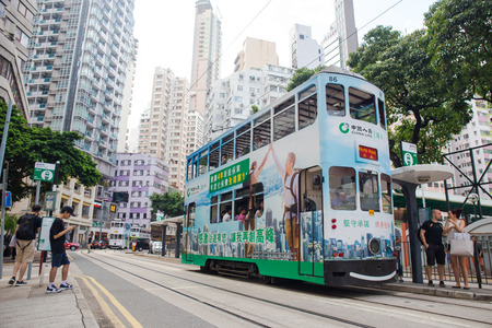 Hong Kong S.A.R. - September 22, 2017: Double decker tram on the street in Wan Chai.Tram or Ding Ding is major tourist attraction and one of the most environmentally friendly ways of travelling in Hong Kong Imagens - 98326809