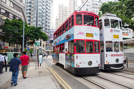 Hong Kong S.A.R. - September 22, 2017: Double decker tram on the street in Wan Chai.Tram or Ding Ding is major tourist attraction and one of the most environmentally friendly ways of travelling in Hong Kong Imagens - 98326810