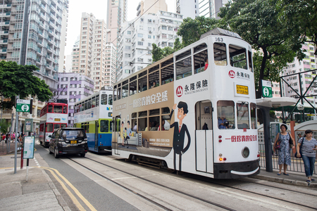 Hong Kong S.A.R. - September 22, 2017: Double decker tram on the street in Wan Chai.Tram or Ding Ding is major tourist attraction and one of the most environmentally friendly ways of travelling in Hong Kong Editorial