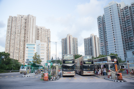 Tsing Yi, Hong Kong- September 22,2017: Double decker bus park at Tsing Yi Bus station with resident building background.Tsing Yi Island is an island in the urban area of Hong Kong with an area of 10.69 sq.km