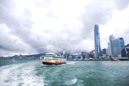 Hong Kong S.A.R.,China - September 24, 2017: Xin Guo ferry ship of New World First Ferry Services depart from Central ferry pier Hong Kong island in cloudy day. The NWFF company was established in November 1999. Editorial