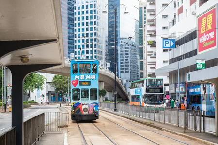 Hong Kong S.A.R. - July 13, 2017: Double decker tram or Ding Ding on the street in Causeway Bay Hong Kong. Hong Kong tramways is one of the earliest forms of public transport in the metropolis Imagens - 98326820