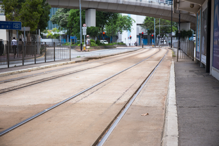 North Point, Hong Kong S.A.R. - July 13, 2017: Double track Tramways on the 73E Tin Chiu street tram stop at Nort Point. Hong Kong tram or Ding Ding is one of the earliest forms of public transport in the metropolis