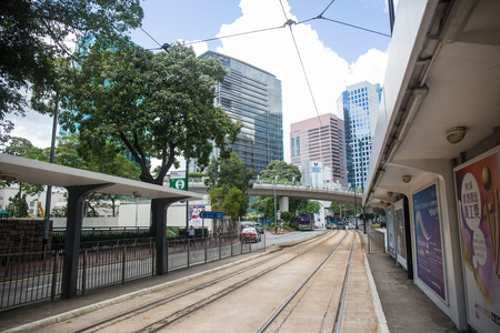 Hong Kong S.A.R. - July 13, 2017: Tram stop on the Tin Chiu street in Nort Point Hong Kong. Hong Kong tram or Ding Ding is one of the earliest forms of public transport in the metropolis Imagens - 98326822