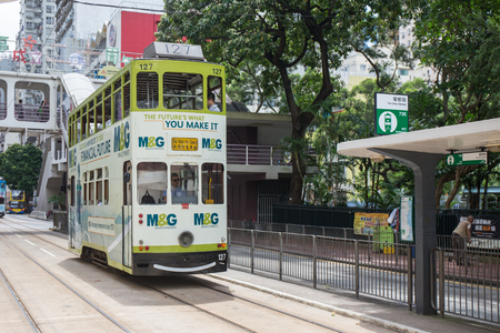 Hong Kong S.A.R. - July 13, 2017: Double decker tram or Ding Ding on the street in Causeway Bay Hong Kong. Hong Kong tramways is one of the earliest forms of public transport in the metropolis Imagens - 98326825
