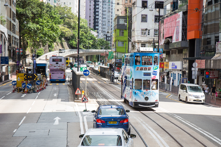 Hong Kong S.A.R. - July 13, 2017: Double decker tram or Ding Ding on jupiter street in Causeway Bay Hong Kong. Tram is major tourist attraction and one of the most environmentally friendly ways of travelling Editorial