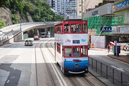 Hong Kong S.A.R. - July 13, 2017: Colorful advertisment on double decker tram or Ding Ding on the street in Causeway Bay Hong Kong. Hong Kong tram is one of the earliest forms of public transport in the metropolis Imagens - 98326831
