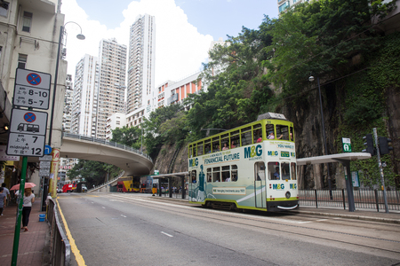 Hong Kong S.A.R. - July 13, 2017: Double decker tram or Ding Ding on the street in Causeway Bay Hong Kong.Tram or Ding Ding is major tourist attraction and one of the most environmentally friendly ways of travelling in Hong Kong Imagens - 98326834