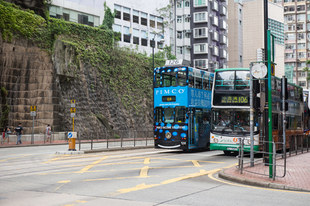 Hong Kong S.A.R. - July 13, 2017: Double decker tram or Ding Ding on the street in Causeway Bay Hong Kong. Hong Kong tramways is one of the earliest forms of public transport in the metropolis Imagens - 98326835