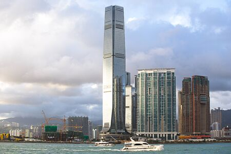 Hong Kong S.A.R.,China - September 24, 2017: ICC - International Commerce Center  the worlds fifth tallest building in Kowloon, Hong Kong at sunset and reflex .The 100th floor called Sky100 which opened to the public in April 2011