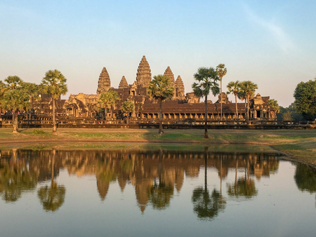 Angkor wat ,Khmer architecture and  at Siem Reap Cambodia with water reflect at sunset Imagens