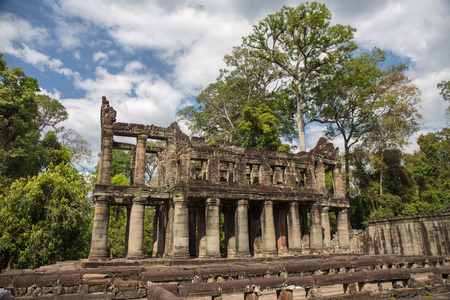 Ancient two-storied building with round columns of Preah Khan the stone temple surround with forest in Angkor , Siem Reap , Cambodia Imagens - 106384116