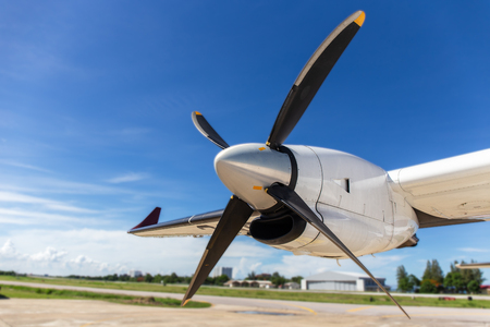 aircraft propeller blade and turboprop engines with airfield, blue sky background and copy space Imagens