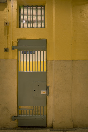 vintage iron jail door in prison building with copy space incinematic tone