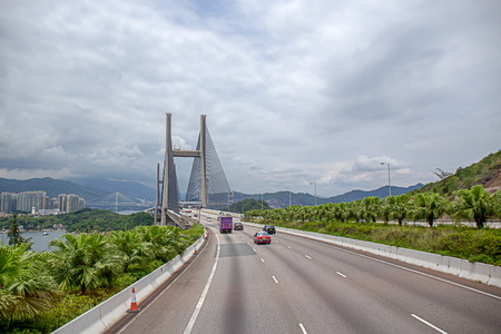 Kap Shui Mun bridge between Ma Wan island and Lantau island in Hong Kong, China by road view with sky background and copy space 版權商用圖片