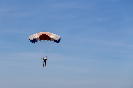 isolated skydiver in colorful parachute gliding after free fall jump with blue sky background  and copy space Imagens - 111271233