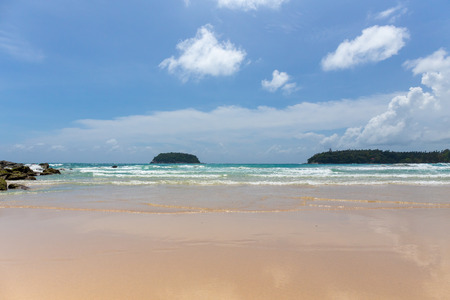 clean and clear sea water with blue sky background in summer season at Kata beach, Phuket island of Thailand