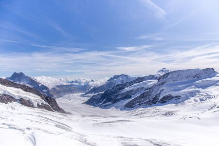 Great Aletsch glacier of Swiss and Bernese Alps and jungfrau snow mountain peak view from Jungfraujoch top of Europe with blue sky in summer background and copy space, Switzerland Imagens - 143586990