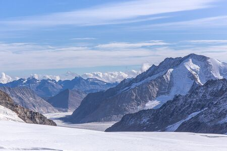 Great Aletsch glacier of Swiss and Bernese Alps and jungfrau snow mountain peak view from Jungfraujoch top of Europe with blue sky in summer background and copy space, Switzerland Imagens - 143587050