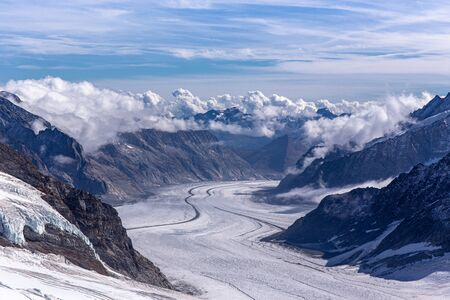 Great Aletsch glacier of Swiss and Bernese Alps and jungfrau snow mountain peak view from Jungfraujoch top of Europe with blue sky in summer background and copy space, Switzerland Imagens - 143587060