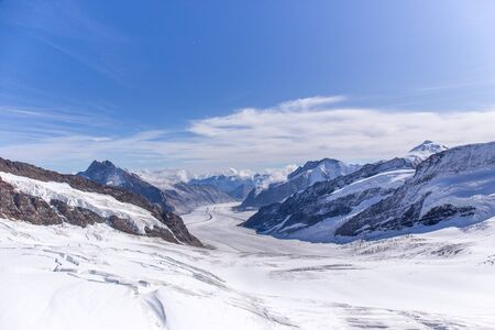 Great Aletsch glacier of Swiss and Bernese Alps and jungfrau snow mountain peak view from Jungfraujoch top of Europe with blue sky in summer background and copy space, Switzerland