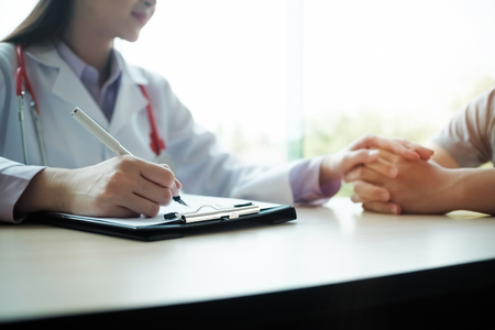 subjective: Doctor is consulting the patient and lighting on window. Stock Photo