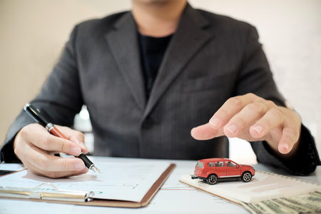 A Man Insurance broker offer protect your car , Insurance auto car concept and Insurance reimbursement vehicle Concept
