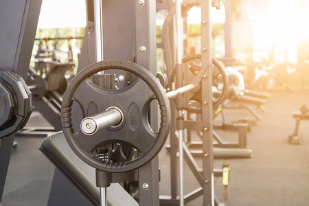 chest press bar and fitness gym background with copy space. Stock Photo