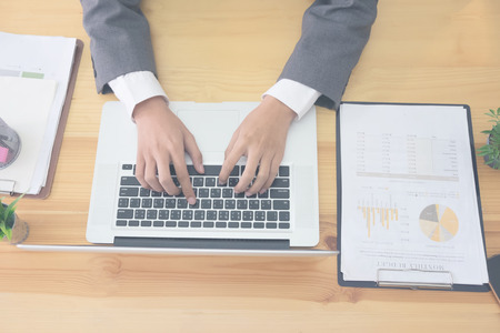 Business using laptop computer hand typing keyboard on business office. Stock Photo