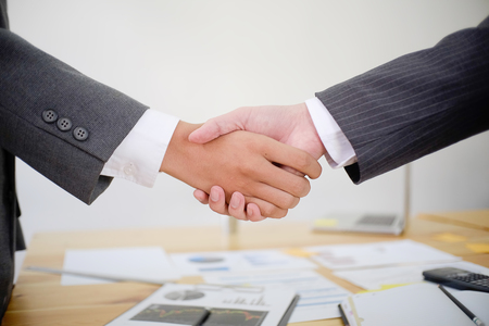 business handshaking in a meeting room,acquisition and partnership concept. Stock Photo