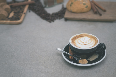 Morning coffee,Latte coffee in cup on table,vintage tone.
