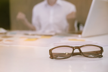 Glasses on business office table,Business success concept.