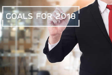 Goal 2018concept, Businessman pointing on text. Business new year card concept. Stock Photo
