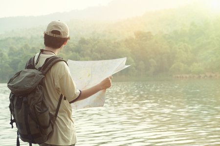 Travel concept,Man on lake and mountains view at holiday time.