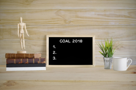 New year resolution on a notepad with decoration for year 2018.