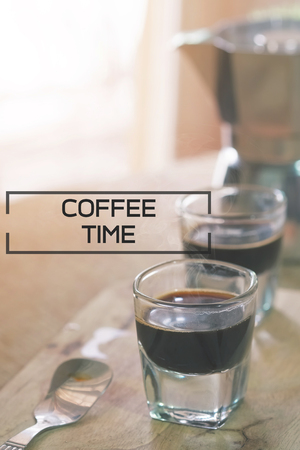 coffee time concept, espresso on wood plate with morning light vintage tone.