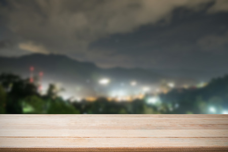 wooden shelf on night city and mountain view on background empty copy space with present product mockup montage.