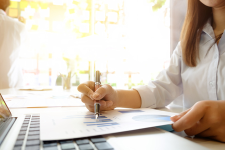 businesswoman working with paper data chart on workplace. Stock Photo