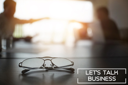 Business talk concept,Glasses on table in Meeting room dark tone and soft focus. Stock Photo