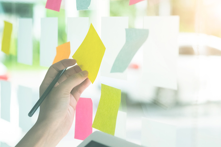 Business hands using sticky note paper with meeting. Stock Photo